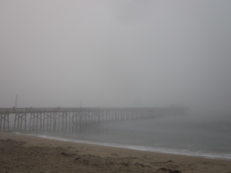pier beach foggy morning