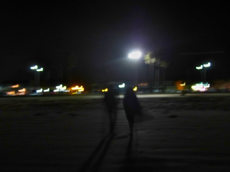 Walking away from the beach at night time