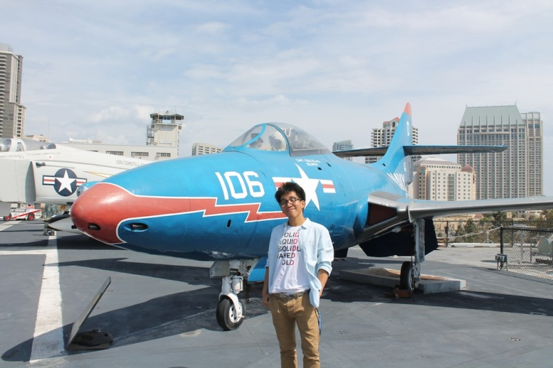 posing in front of a cool blue plane
