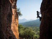 Ivan climbing a 6A at Magara Wall
